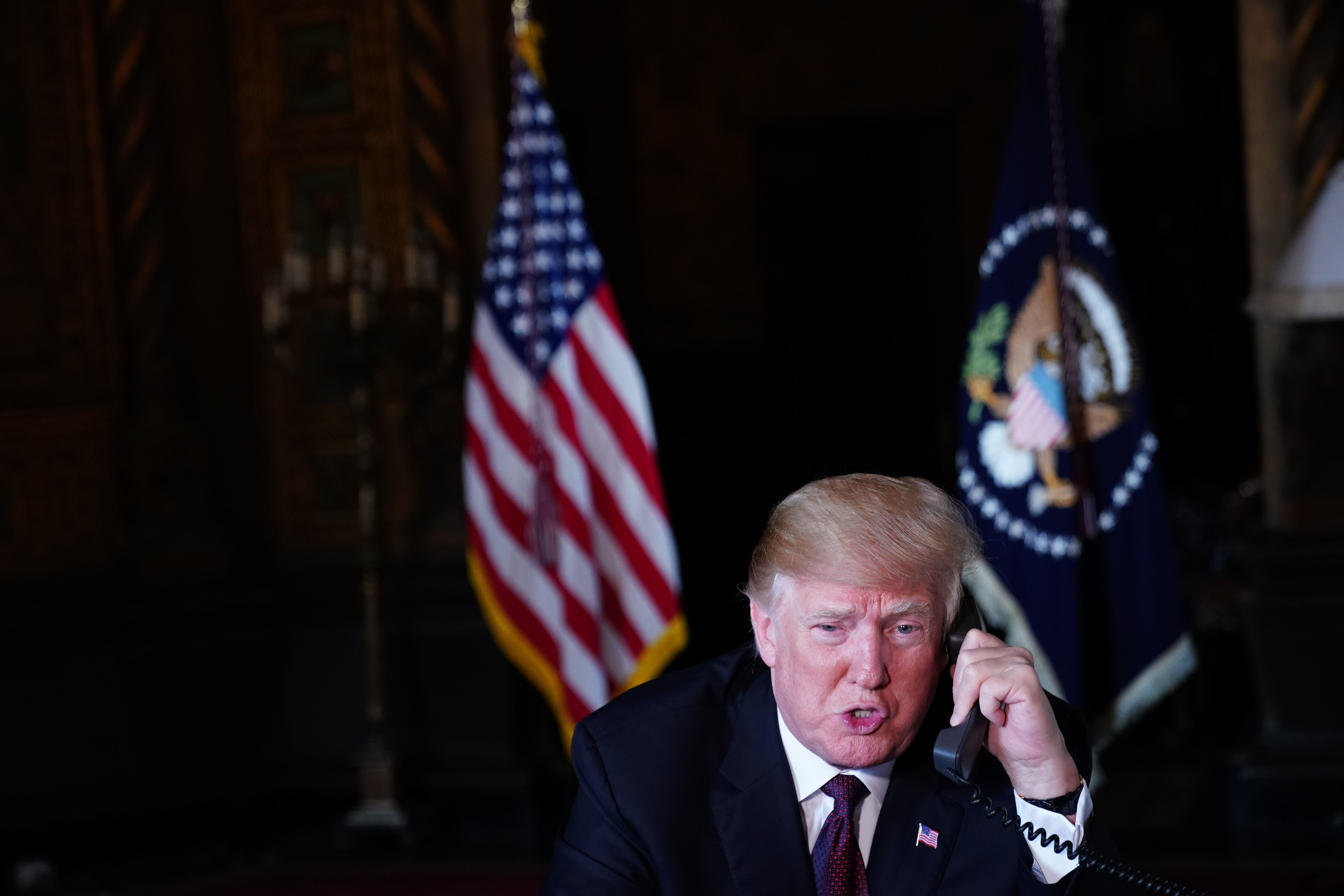 US President Donald Trump speaks to members of the military via teleconference from his Mar-a-Lago resort in Palm Beach, Florida, on Thanksgiving Day, November 22, 2018. (Photo by Mandel NGAN / AFP)        (Photo credit should read MANDEL NGAN/AFP/Getty Images)