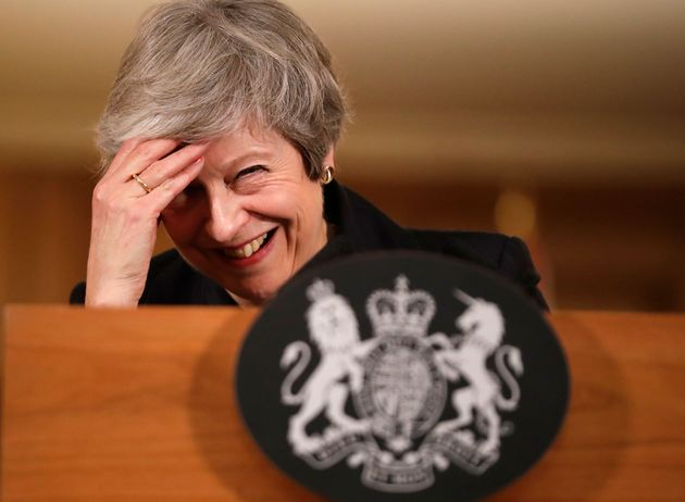 May laughs off her mistake during her press conference last
