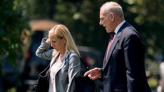 President Donald Trump's Chief of Staff John Kelly and President Donald Trump's Deputy Chief of Staff Kirstjen Nielsen speak together as they walk across the South Lawn to board Marine One at the White House in Washington, Tuesday, Aug. 22, 2017, for a short trip to Andrews Air Force Base, Md. and then onto Yuma, Ariz. to visit the U.S. border with Mexico and attend a rally in Phoenix with President Donald Trump. (AP Photo/Andrew Harnik)