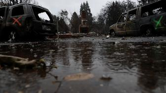 PARADISE, CA - NOVEMBER 22:  Rain falls on a home destroyed by the Camp Fire on November 22, 2018 in Paradise, California. Fueled by high winds and low humidity the Camp Fire ripped through the town of Paradise charring over 150,000 acres, killed at least 84 people and has destroyed over 18,000 homes and businesses. The fire is currently at 85 percent containment and hundreds of people still remain missing.  (Photo by Justin Sullivan/Getty Images)