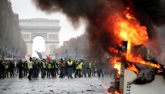 Paris Protests: Police Fire Tear Gas And Water Canons At