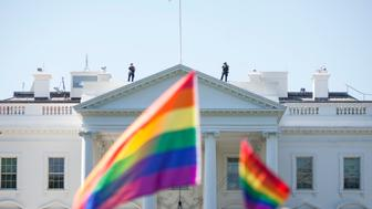 WASHINGTON, DC - JUNE 11:  Demonstrators carry rainbow flags past the White House during the Equality March for Unity and Peace on June 11, 2017 in Washington, D.C. Thousands around the country participated in marches for the LGBTQ communities, the central march taking place in Washington.  (Photo by Zach Gibson/Getty Images)