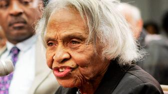 FILE- In this May 10, 2005, file photo survivor of the 1921 Tulsa race riots, Dr. Olivia Hooker, 90, gives her personal account of the of the historic race riot at a briefing before members of the Congressional Black Caucus and other leaders on Capitol Hill in Washington. Hooker, one of the last survivors of the race riot, one of the worst race riots in U.S. history, has died at age 103. (AP Photo/Manuel Balce Ceneta, File)