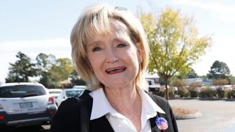 Sen. Cindy Hyde-Smith, R-Miss., campaigns with Teresa Carter, a old friend from Kentucky, Tuesday, Nov. 6, 2018, at Mama Hamil's Restaurant in Madison, Miss.  (AP Photo/Rogelio V. Solis)