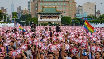 TAIPEI, TAIWAN - 2018/11/18: A huge crowd takes part of the LGBT organized rally in occasion of the incoming referendum on gays and lesbians rights to marry. Taiwan was the first Asian country to legalize such marriage but there are still legal issues that need to be resolved through a referendum. In the referendum people will be asked to answer yes or no to a series of questions that concerned some technicalities of the marriage. here the crowd lift a placard that indicates what questions must be answered with a no. (Photo by Alberto Buzzola/LightRocket via Getty Images)