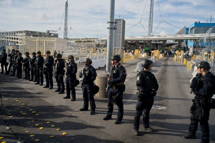 U.S. Customs and Border Protection agents stand guard at the San Ysidro port of entry on the U.S.-Mexico border, seen from Ti