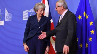 European Commission President Jean-Claude Juncker, right, reaches out to shake hands with British Prime Minister Theresa May prior to a meeting at EU headquarters in Brussels, Saturday, Nov. 24, 2018. British Prime Minister Theresa May is kicking off a big Brexit weekend by traveling to EU headquarters in Brussels for talks on Saturday with key leaders. (AP Photo/Geert Vanden Wijngaert)