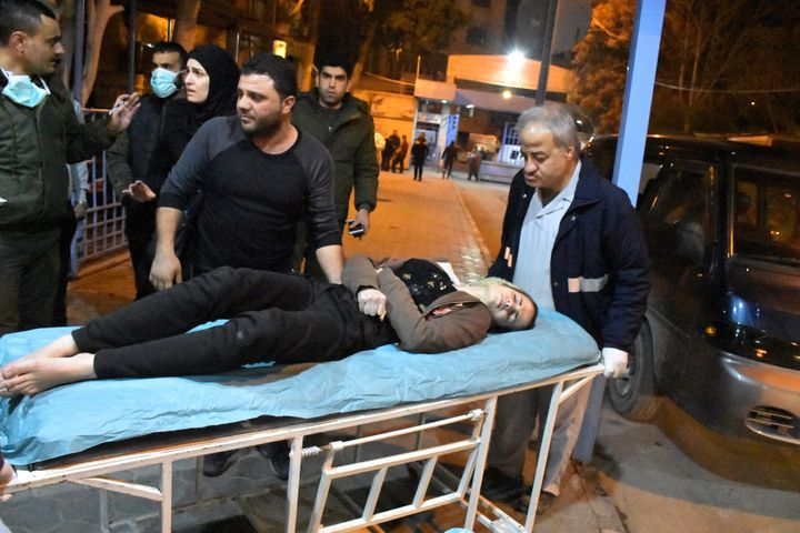 Awoman lies on a stretcher after what the Syrian state media said was a suspected toxic gas attack in Aleppo, Syria, on