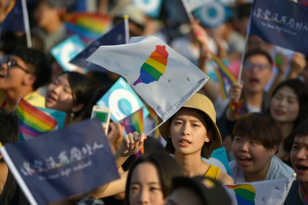 People take part in a rally in support of same-sex marriage near the Presidential Office in Taipei on...