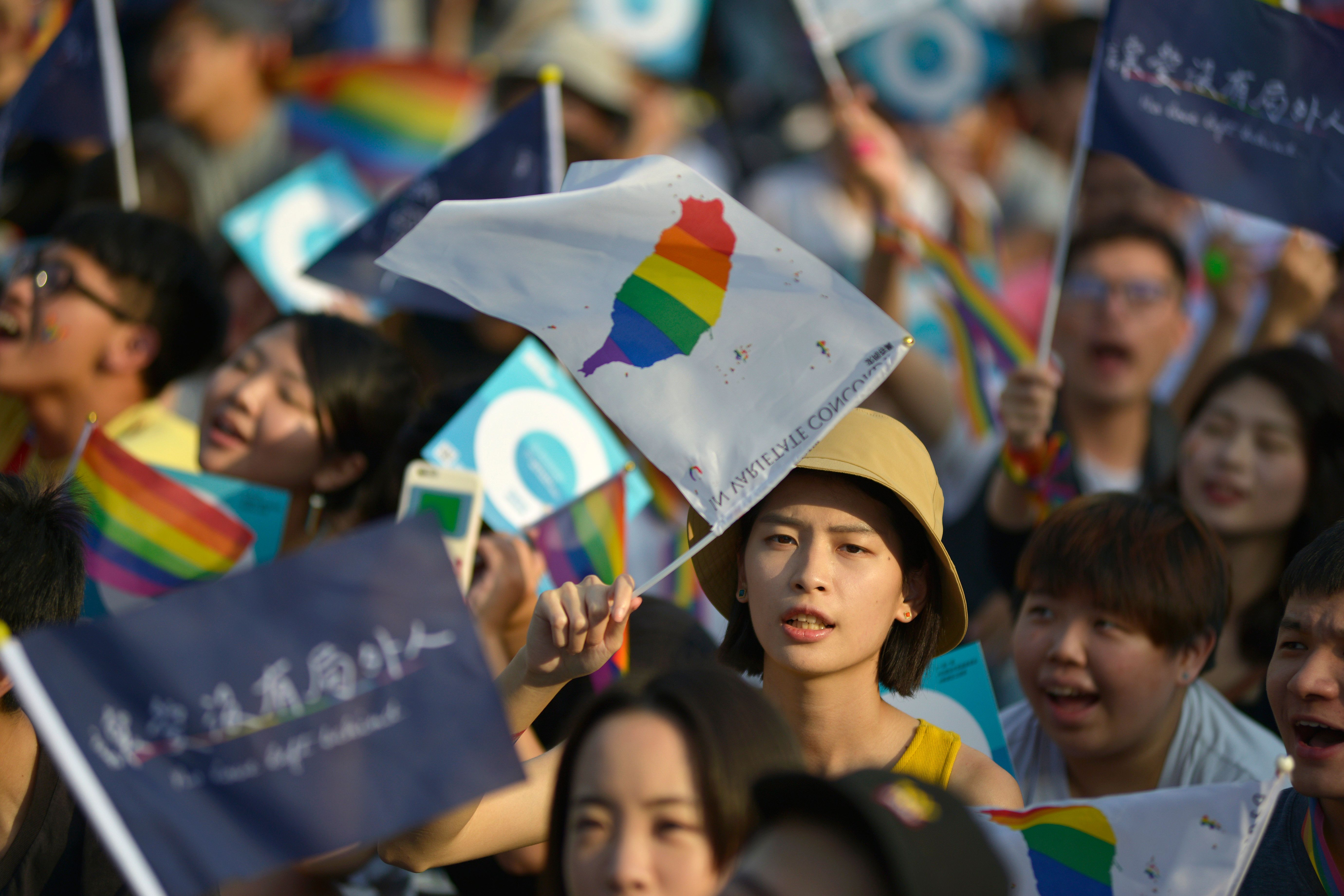 People take part in a rally in support of same-sex marriage near the Presidential Office in Taipei on November 18, 2018, ahead of a landmark vote on LGBT rights on November 24. - Taiwan's top court in May 2017 legalised gay marriage, the first place in Asia to do so, and ruled its decision must be implemented within two years. (Photo by Chris STOWERS / AFP)        (Photo credit should read CHRIS STOWERS/AFP/Getty Images)