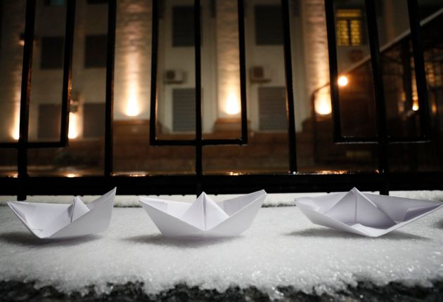 Paper boats are seen placed during a protest against the seizure by Russian special forces of three of...