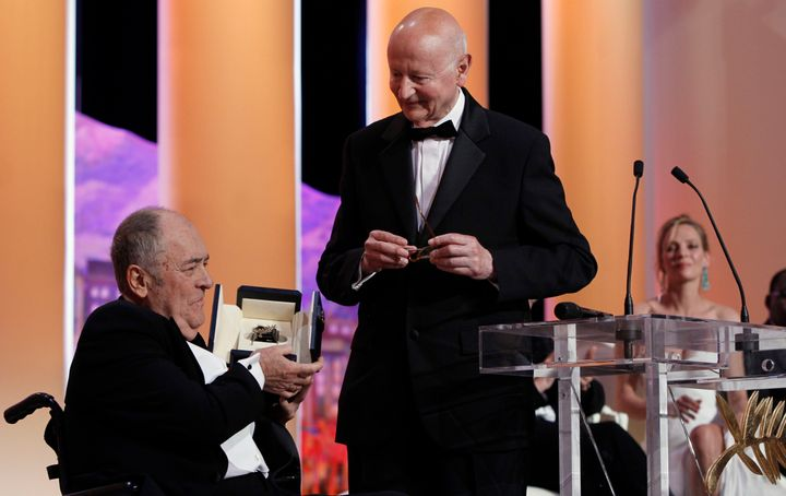 Italian Director Bernardo Bertolucci, left, receives a 'Palme d'Honneur' from President of the Cannes Film Festival Gilles Ja