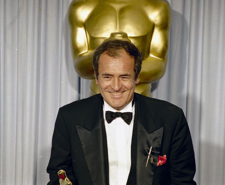 "April 29, 1988 file photo of Italian film director Bernardo Bertolucci after he won the Best Director award for his movie ""Th"