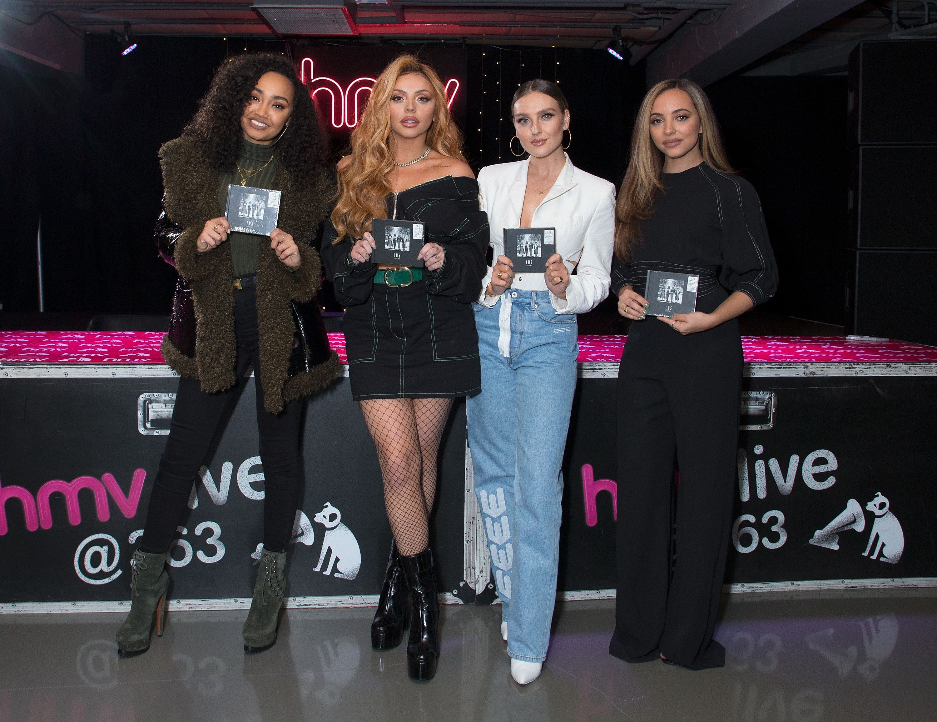 LONDON, ENGLAND - NOVEMBER 19:  (L-R) Leigh_Anne Pinnock, Jesy Nelson, Perrie Edwards and Jade Thirlwall sign copies of their new Album LM5 at HMV Oxford Street on November 20, 2018 in London, England.  (Photo by Jo Hale/Redferns)
