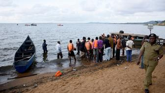 ATTENTION EDITORS - VISUAL COVERAGE OF SCENES OF INJURY OR DEATH  Rescue and recovery missions gather at the shores of Lake Victoria during the search for the bodies of dead passengers after a cruise boat capsized off Mukono district, Uganda November 25, 2018. REUTERS/Newton Nambwaya TEMPLATE OUT