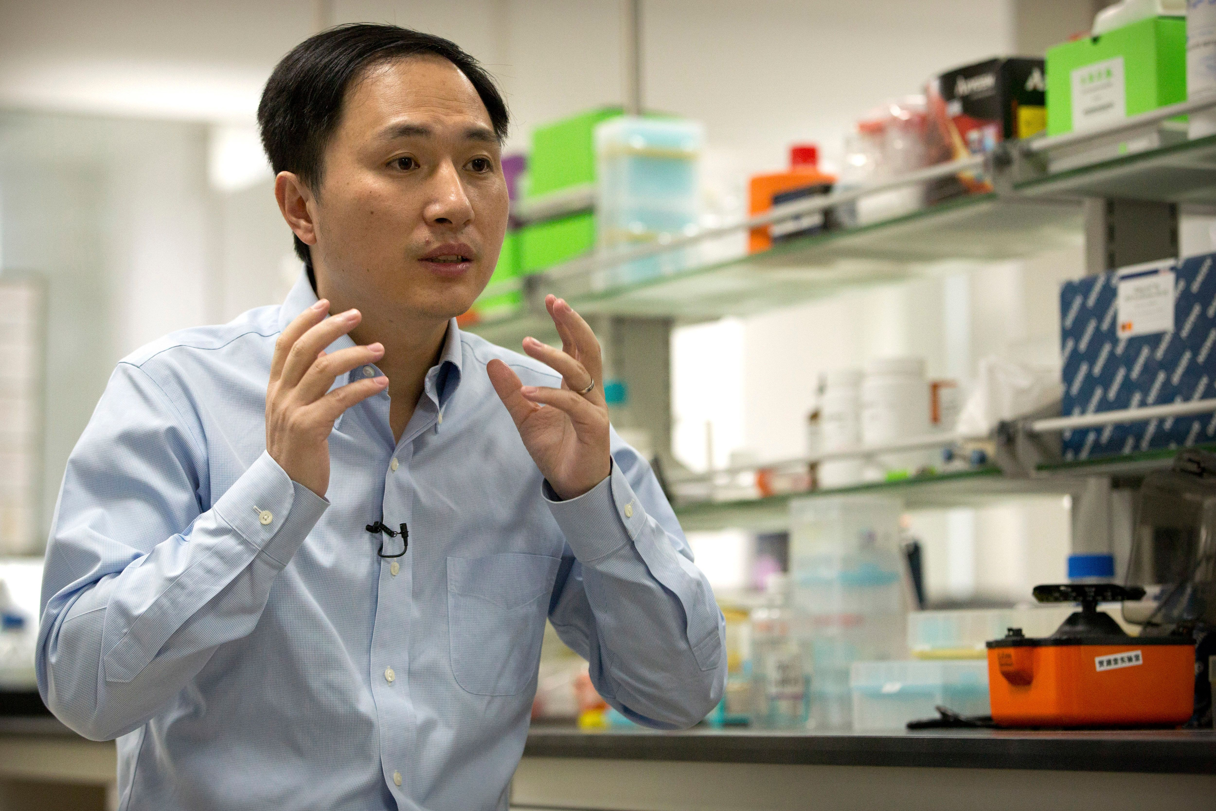 In this Oct. 10, 2018 photo, He Jiankui speaks during an interview at a laboratory in Shenzhen in southern China's Guangdong province. Chinese scientist He claims he helped make world's first genetically edited babies: twin girls whose DNA he said he altered. He revealed it Monday, Nov. 26, in Hong Kong to one of the organizers of an international conference on gene editing. (AP Photo/Mark Schiefelbein)