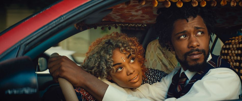 """Since the early '90s, Boots Riley has been a rapper and activist. Now he's a first-rate filmmaker, too. His inventive debut, """"Sorry to Bother You,"""" is a surreal head trip starring the fantastic Lakeith Stanfield as a hard-up telemarketer who learns that climbing his company's ladder means coming face to face with a shadowy hierarchy that threatens to change the world. Surprise, surprise: Corporate mobility requires selling your soul, or worse. This movie, as giddy as it may be, doesn't horse around."""