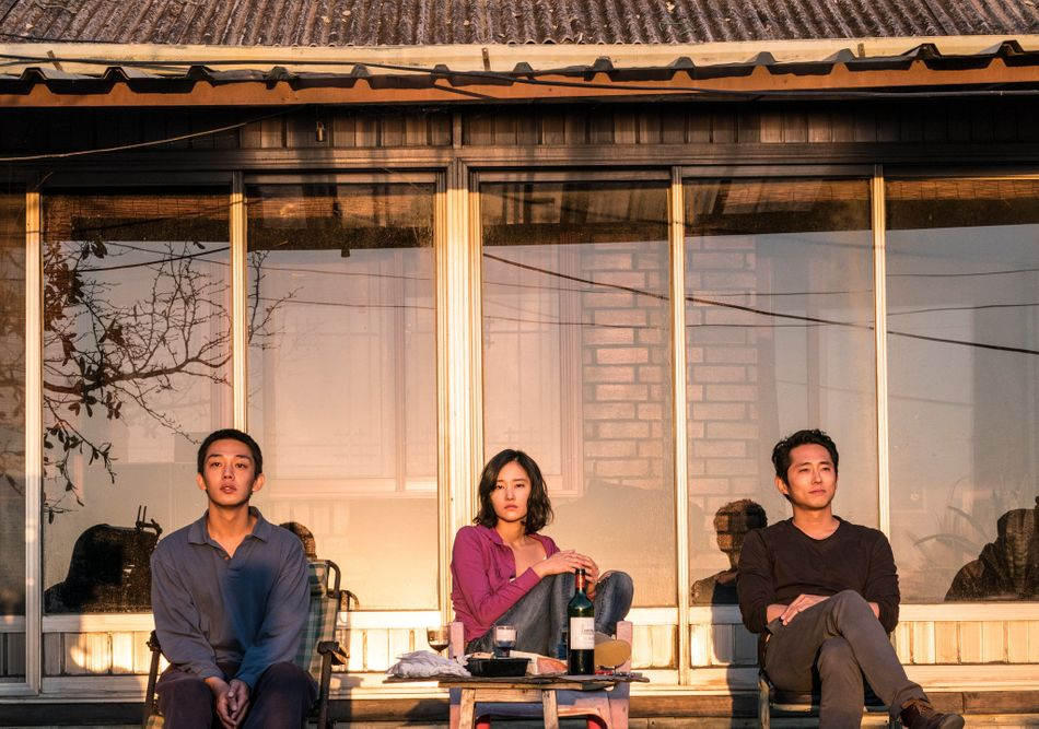 """The greatest fear is that of the unknown, which Korean director Lee Chang-dong mines in this seductive thriller about an ambling wannabe writer (Yoo Ah-in) and a love triangle involving a former classmate (Jeon Jong-seo) and a mysterious interloper (Steven Yeun). With a lilting build, """"Burning"""" kicks into high gear at the midway point, when Miles Davis' horns serenade a hazy sunset that could lead to anything: dancing, disrobing, disarmament, utter disorientation. Lee's source material is a Haruki Murakami short story, so alienation remains a constant villain. """"Burning"""" wonders how much we can ever really know another person. Its inability to answer that question makes the film all the more searing."""