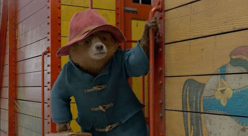 """The hype is real. Many kiddie movies aim for the grown-up rafters, but few reach them as triumphantly as """"Paddington 2."""" The gentle bear's pratfalls make for the year's cleverest sight gags, and his mishaps its most sophisticated whimsy. Prison breaks! Hidden fortunes! An evil Hugh Grant! Director and co-writer Paul King, besting himself after 2014's predecessor, achieves an earnestness that is open-hearted instead of cloying -- exactly the distraction we needed in a hellish 2018. This marmalade glaze is a perfect spread."""