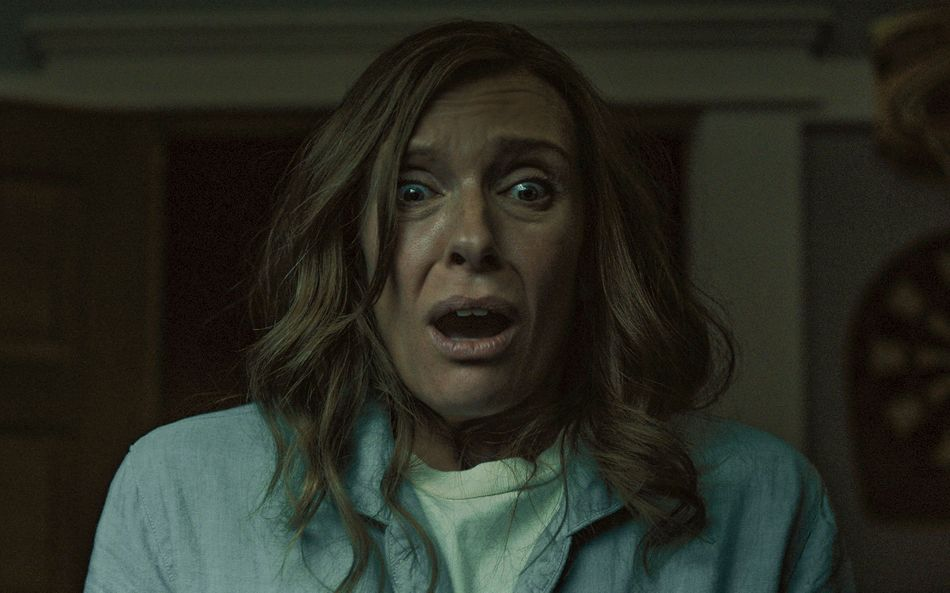 """The devil's in the details, and the details are probably sitting in your attic. Diorama artist Annie Graham (Toni Colette) finds out the harrowing way: first by mourning her mother's death, then by watching her family -- and its eerie secrets -- unravel. """"Hereditary,"""" written and directed by first-timer Ari Aster, joins the many horror staples that filter grief through supernatural and demonic specters (""""Don't Look Now,"""" """"The Others,"""" """"The Babadook""""). Loss, after all, haunts victims much as a ghost would: It is slow, bizarre and sometimes fatal. But Aster also looks beyond his characters' maladjustment, actualizing the occult elements that another storyteller might render metaphorical. You'll be clucking in your nightmares."""