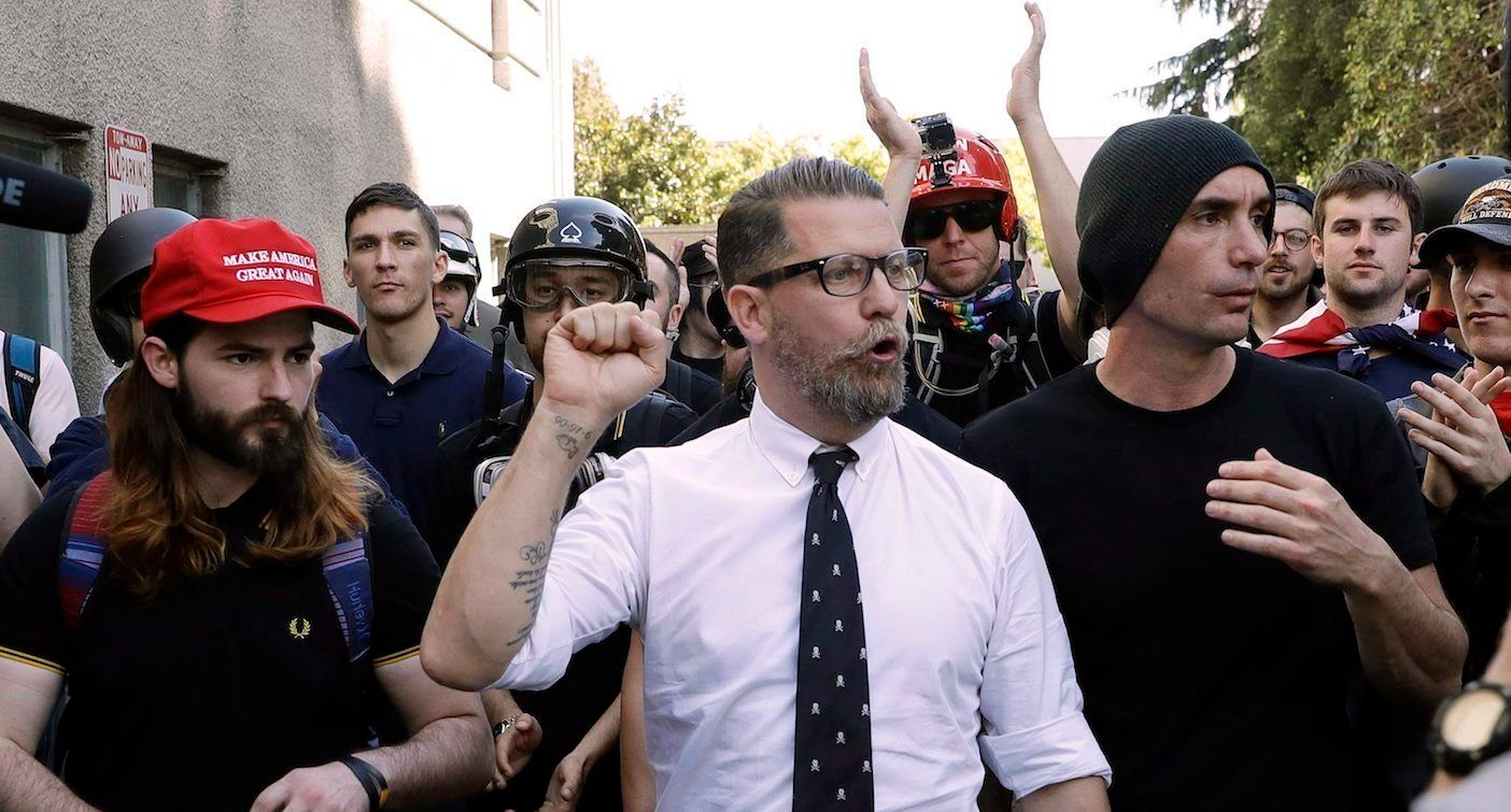 In this April 27, 2017 file photo, Gavin McInnes, center, founder of the far-right group Proud Boys, is surrounded by supporters after speaking at a rally in Berkeley, Calif.  (AP/CP)