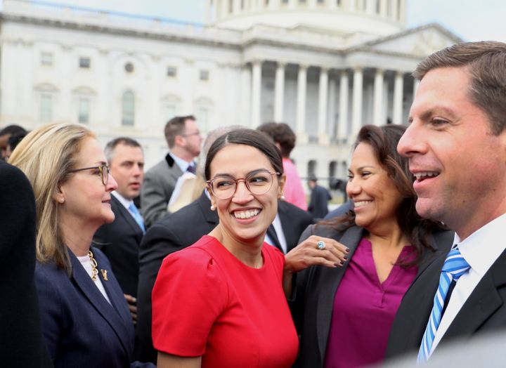 Rep.-elect Alexandria Ocasio-Cortez, a Democrat from New York, smiles after a group photo with the 116th Congress outside the U.S. Capitol on Nov. 14, 2018.