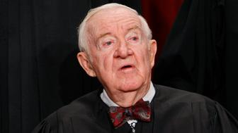 FILE - In this Sept. 29, 2009, file photo Associate Justice John Paul Stevens sits for a new group photograph at the Supreme Court in Washington. Stevens, leader of Supreme Court's liberals, to retire this summer. (AP Photo/Charles Dharapak, File)