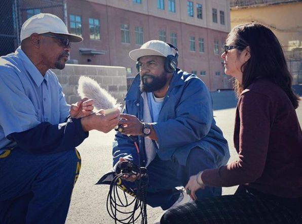 Earlonne Woods, center, and Nigel Poor, right, interview an inmate at San Quentin state prison for the Ear Hustle podcast