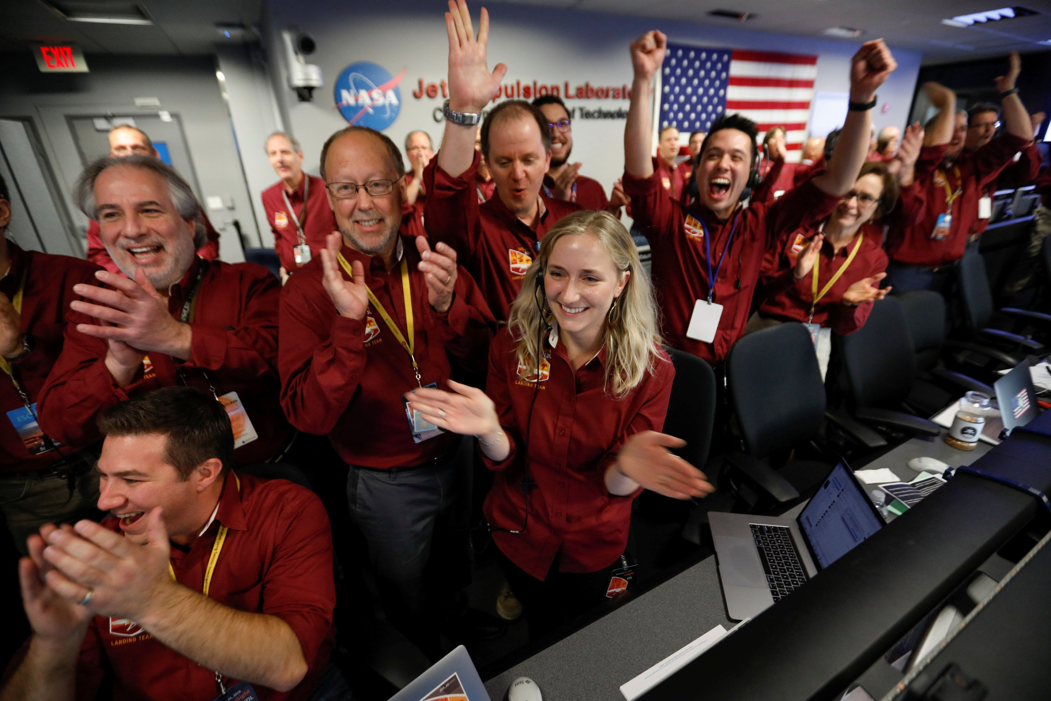 Reuters               Engineers at the Jet Propulsion Laboratory celebrate