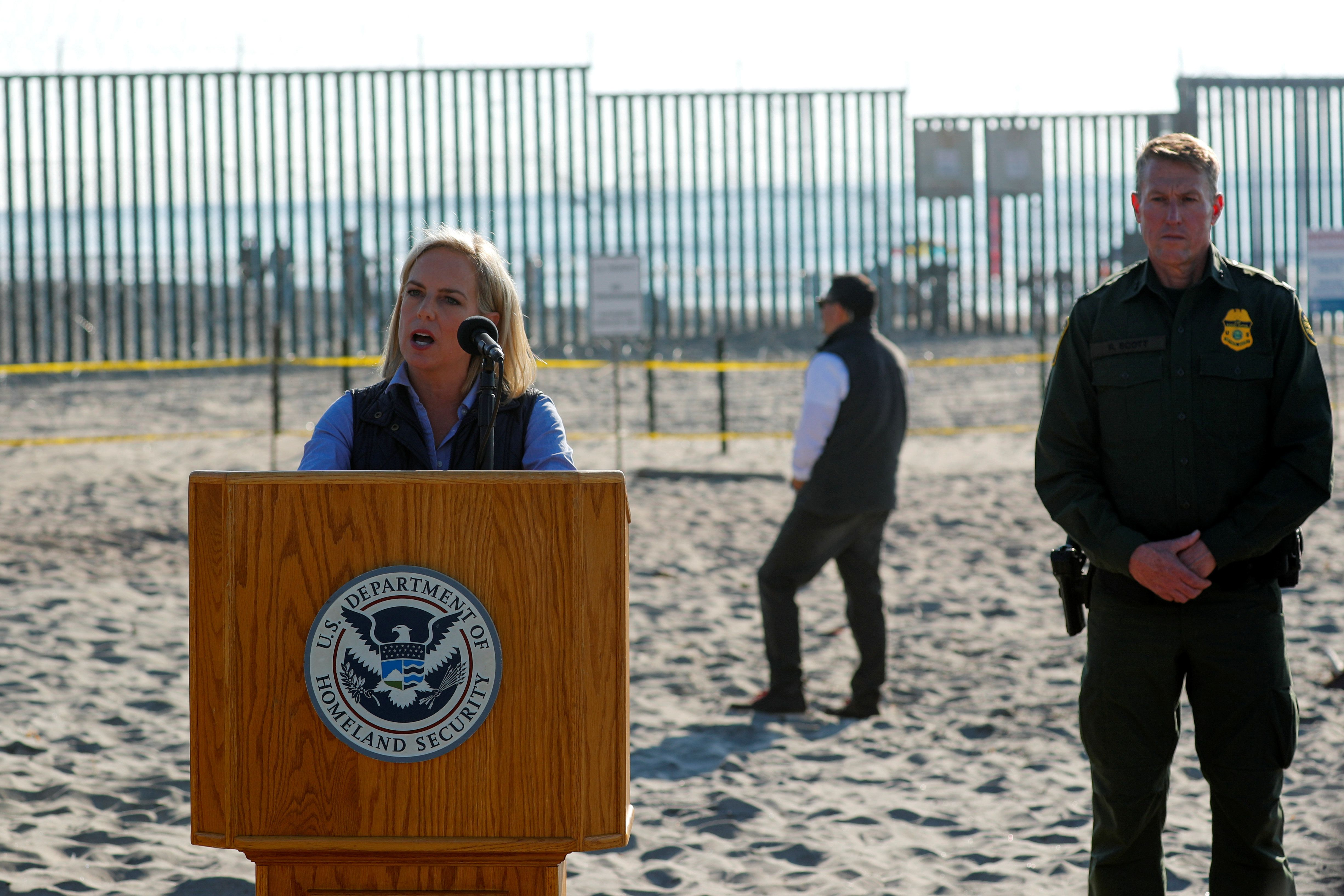 U.S. Secretary of Homeland Security Kirstjen M. Nielsen speaks next to the U.S. Mexico border at Border Field State Park in San Diego, California, U.S. November 20, 2018.   REUTERS/Mike Blake