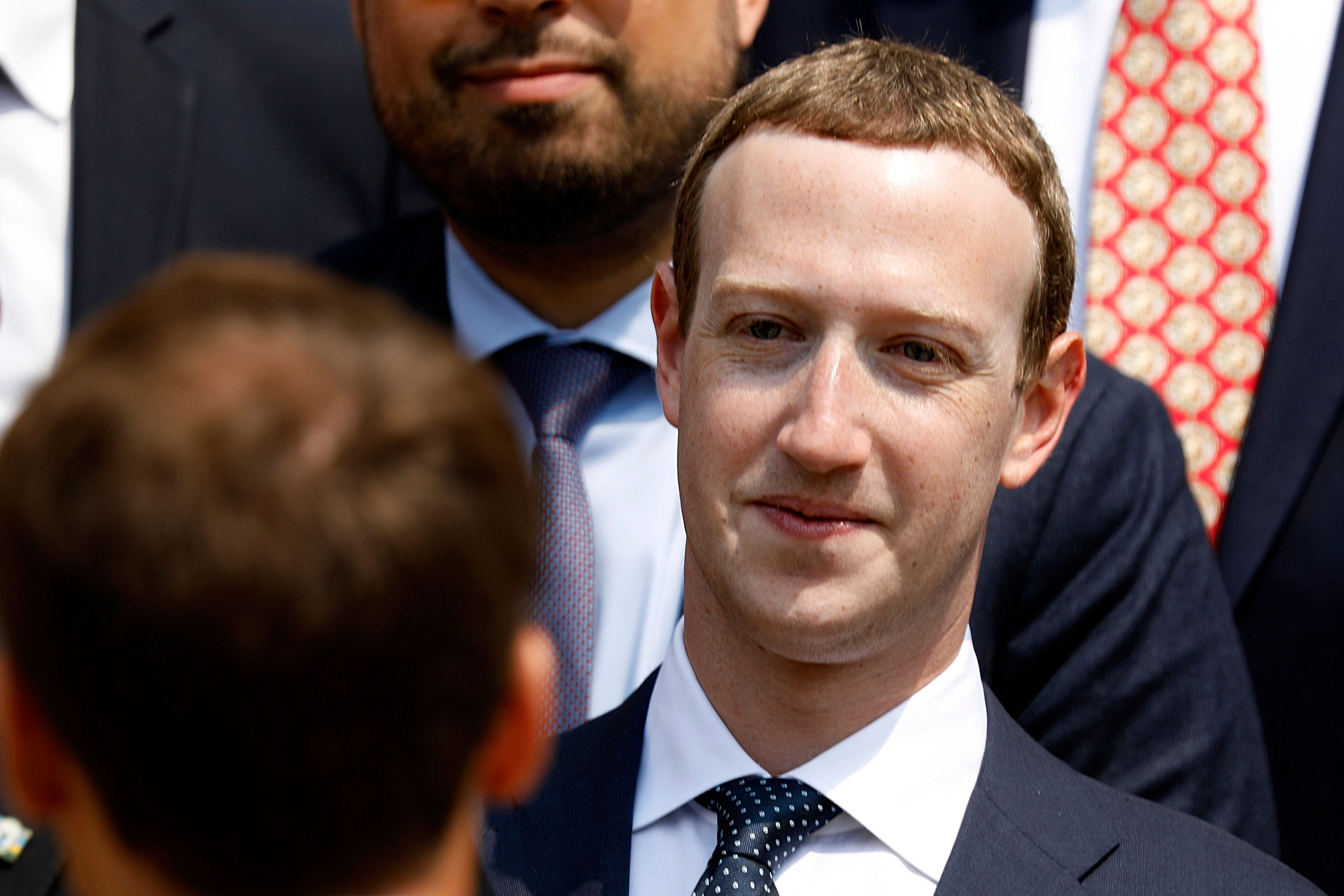 "Facebook's CEO Mark Zuckerberg listens to French President Emmanuel Macron after a family picture with guests attending the ""Tech for Good"" Summit at the Elysee Palace in Paris, Wednesday, May 23, 2018. French President Emmanuel Macron seeks to persuade Facebook CEO Mark Zuckerberg and other internet giants to discuss tax and data protection issues at a Paris meeting set to focus on how they could use their global influence for the public good. (Charles Platiau,Pool via AP)"