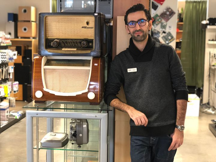 Amjad Al Chamma in his electronics store.