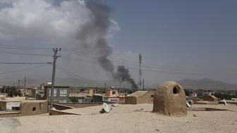 Smoke rising into the air after Taliban militants launched an attack on the Afghan provincial capital of Ghazni on August 10, 2018. - US forces launched airstrikes on August 10 to counter a major Taliban assault on an Afghan provincial capital, where terrified residents cowered in their homes amid explosions and gunfire as security forces fought to beat the insurgents back. (Photo by ZAKERIA HASHIMI / AFP)        (Photo credit should read ZAKERIA HASHIMI/AFP/Getty Images)