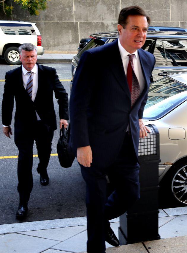 Former Trump campaign chairman Paul Manafort (right) secretly met with WikiLeaks founder Julian Assange...
