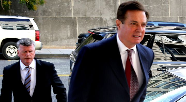 Former Trump campaign chairman Paul Manafort (right) secretly met with WikiLeaks founder Julian Assange on multiple occasions