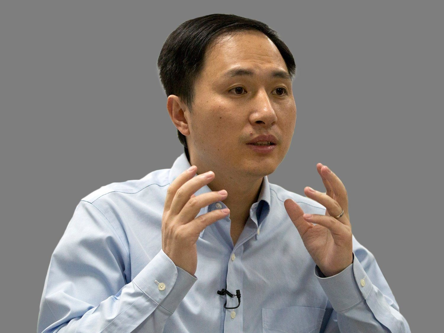 He Jiankui headshot, as scientist, graphic element on gray