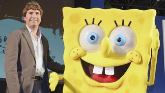 TOKYO, JAPAN - MARCH 23: Stephen Hillenburg, the writer of a U.S. cartoon 'The SpongeBob SquarePants' poses with its charactor SpongeBob SquarePants at an event held at Tokyo International Anime Fair on March 23, 2006 in Tokyo, Japan. The film of this popular U.S. Cartoon will open on April 22 in Japan. (Photo by Junko Kimura/Getty Images)