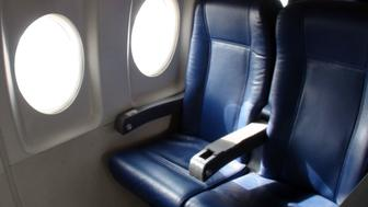 Interior Of Passengers Airplane With Empty Seats Scene At Airport