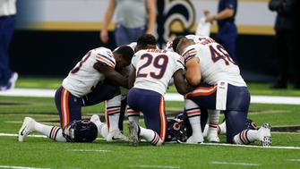Chicago Bears players kneel together before an NFL football game against the New Orleans Saints in New Orleans, Sunday, Oct. 29, 2017. (AP Photo/Butch Dill)