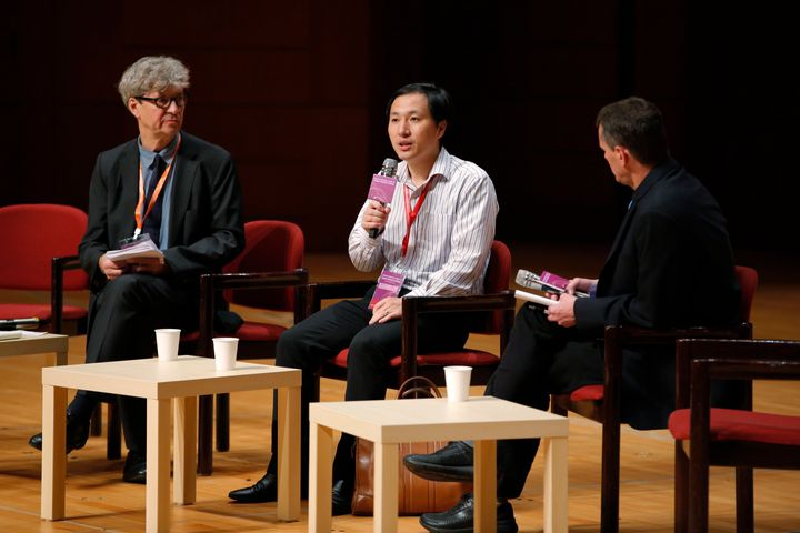 He Jiankui, a Chinese researcher, center, speaks during the Human Genome Editing Conference in Hong Kong, Wednesday, Nov. 28,