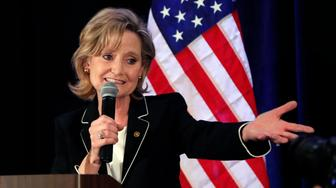 Republican U.S. Sen. Cindy Hyde-Smith calls on her family members to identify themselves as she celebrates her runoff win over Democrat Mike Espy in Jackson, Miss., Tuesday, Nov. 27, 2018. Hyde-Smith will now serve the final two years of retired Republican Sen. Thad Cochran's six year term. (AP Photo/Rogelio V. Solis)