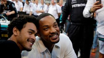 US actor Will Smith (R) and his son Trey visit the pit lane during the Abu Dhabi Formula One Grand Prix at the Yas Marina circuit on November 25, 2018, in Abu Dhabi. (Photo by Luca Bruno / POOL / AFP)        (Photo credit should read LUCA BRUNO/AFP/Getty Images)