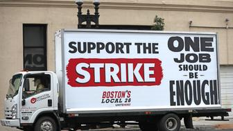 BOSTON, MA - OCTOBER 3: A truck bearing a 'Support the Strike' sign is pictured outside of the Westin Boston Waterfront during a hotel workers strike on Oct. 3, 2018. Hotel workers walked off the job at seven Marriott hotels in Boston Wednesday morning, launching the first hotel strike in the city's history following months of fruitless contract negotiations. The job action involves more than 1,500 Marriott International employees, from housekeepers to bartenders to bellmen at the Aloft Boston Seaport District, Element Boston Seaport District, Ritz-Carlton Boston, Sheraton Boston, W Hotel Boston, Westin Boston Waterfront, and Westin Copley Place. (Photo by David L. Ryan/The Boston Globe via Getty Images)