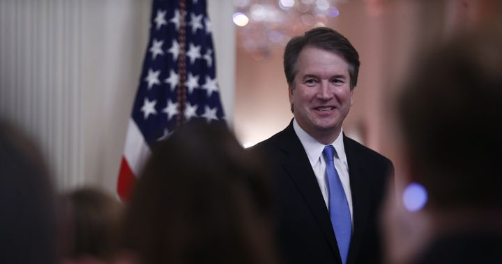 Brett Kavanaugh, associate justice of the U.S. Supreme Court, smiles as U.S. President Donald Trump speaks during a ceremonial swearing-in event in the East Room of the White House in Washington, D.C., U.S., on Monday, Oct. 8, 2018.