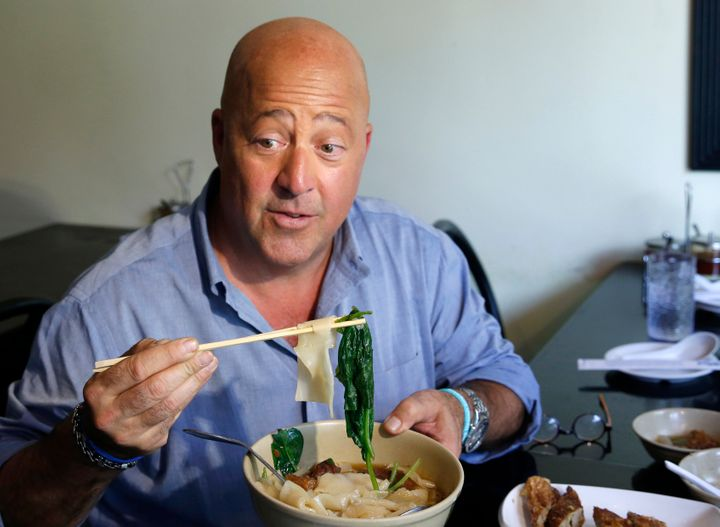 Andrew Zimmern samples Taiwanese noodle soup and pork roll at Happy Stony Noodle in Elmhurst, Queens, in New York.