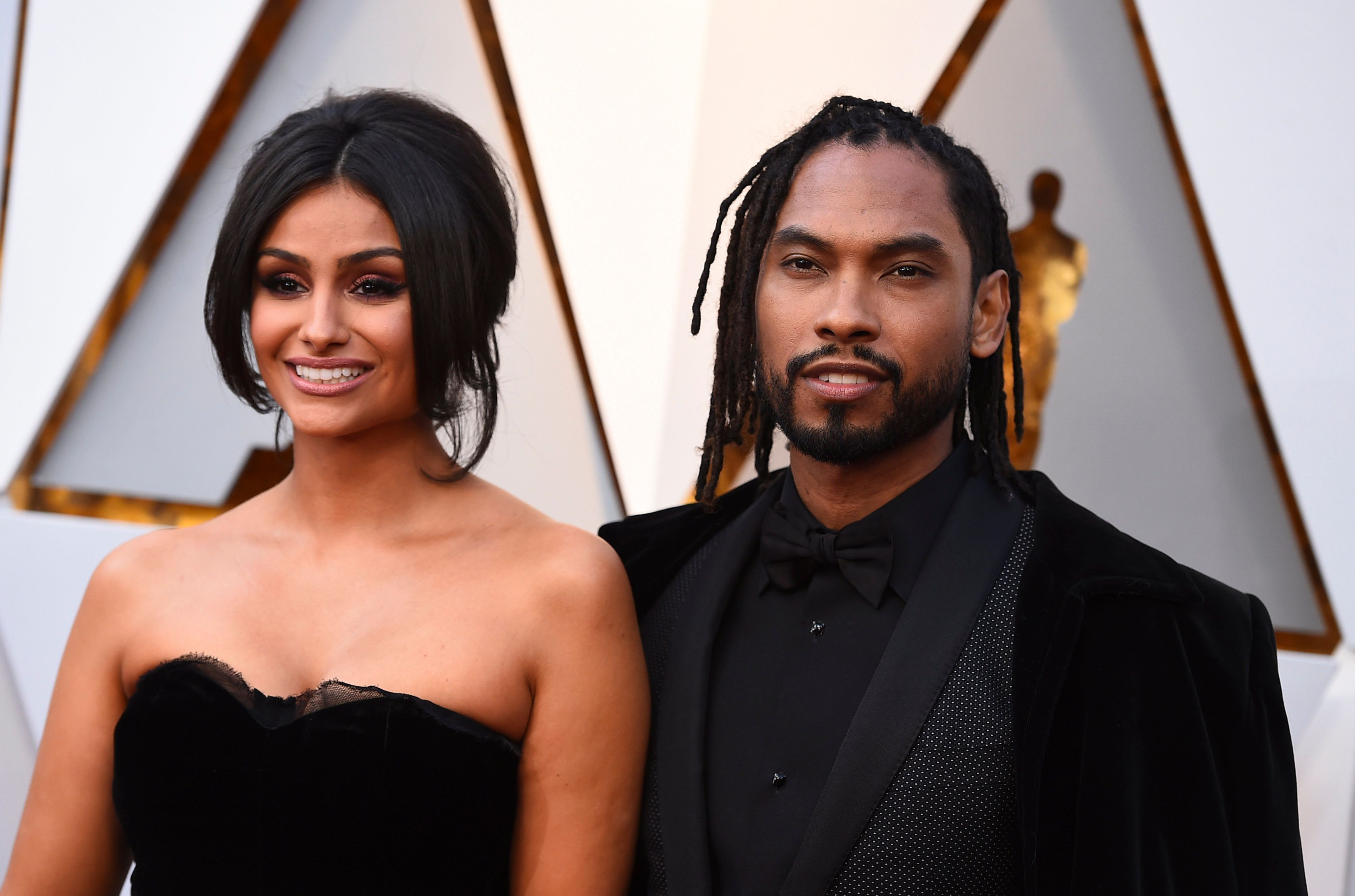 Nazanin Mandi, left, and Miguel arrive at the Oscars on Sunday, March 4, 2018, at the Dolby Theatre in Los Angeles. (Photo by Jordan Strauss/Invision/AP)