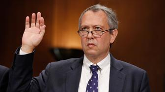 Thomas Alvin Farr is sworn in during a Senate Judiciary Committee hearing on his nomination to be a District Judge on the United States District Court for the Eastern District of North Carolina, on Capitol Hill, Wednesday, Sept. 20, 2017 in Washington. (AP Photo/Alex Brandon)