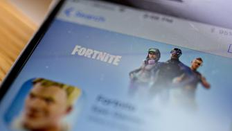 The Epic Games Inc. Fortnite: Battle Royale video game is seen in the App Store on an Apple Inc. iPhone displayed for a photograph in Washington, D.C., U.S., on Thursday, May 10, 2018. Fortnite, the hitgamethat's denting the stock prices of video-gamemakers after signing up 45 million players, didn't really take off until it became free and a free-for-all. Photographer: Andrew Harrer/Bloomberg via Getty Images