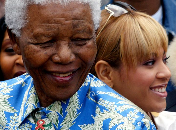 Nelson Mandela and Beyoncé visit Robben Island Prison in Cape Town, South Africa, in 2004.