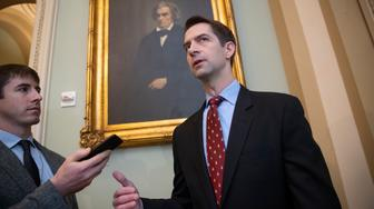 Sen. Tom Cotton, R-Ark., speaks to reporters as he arrives for a meeting with fellow Republicans, including Vice President Mike Pence and President Donald Trump's son-in-law, Jared Kushner, who are at the Capitol to discuss the nation's criminal justice sentencing laws, in Washington, Tuesday, Nov. 27, 2018. (AP Photo/J. Scott Applewhite)